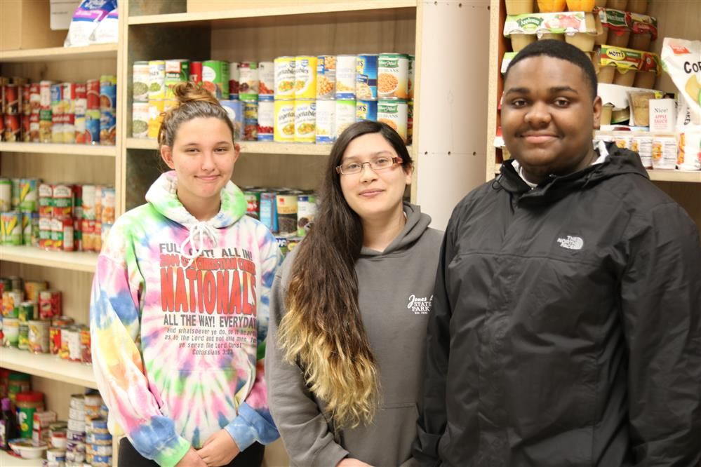 Three East Bladen students in the food pantry