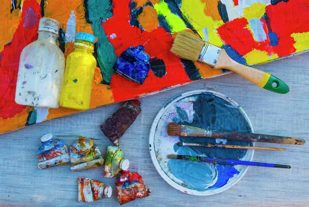 art canvas with paint supplies